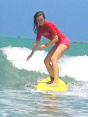 girl surfing lesson
